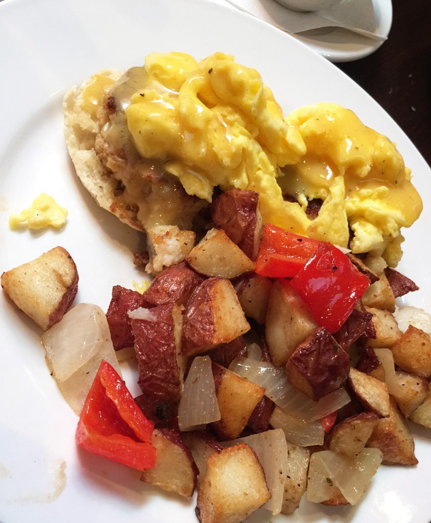 Crab Cakes Benedict served with home fried potatoes, Front Page News, Midtown, Atlanta
