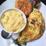 Made to order Omelet served with biscuit and grits, Front Page News, Midtown, Atlanta